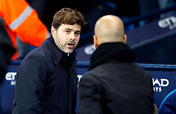 Tottenham Hotspur manager Mauricio Pochettino and Manchester City manager Pep Guardiola (left) during the Premier League match at the Etihad Stadium, Manchester.