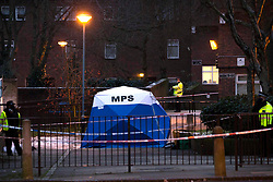 © Licensed to London News Pictures.26/01/2021, London,UK. Police guard a crime scene after a fatal stabbing in Islington north London. At approximately 5:30pm police were called yesterday to a report of stabbing. Despite the effort of medics a teenage boy was pronounced dead at the scene. One male has been arrested. Photo credit: Marcin Nowak/LNP