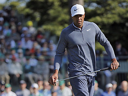 April 6, 2018 - Augusta, GA, USA - Tony Finau reacts to missing his par putt on  the first hole, which he bogey'd, during the second round of the Masters at Augusta National Golf Club on Friday, April 6, 2018, in Augusta, Ga. (Credit Image: © Bob Andres/TNS via ZUMA Wire)