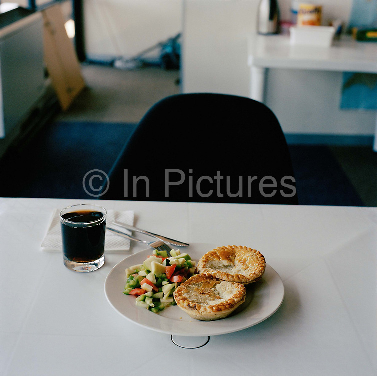 Lunch time at a call centre in Capetown, South Africa.  From the series Desk Job, a project which explores globalisation through office life around the World.