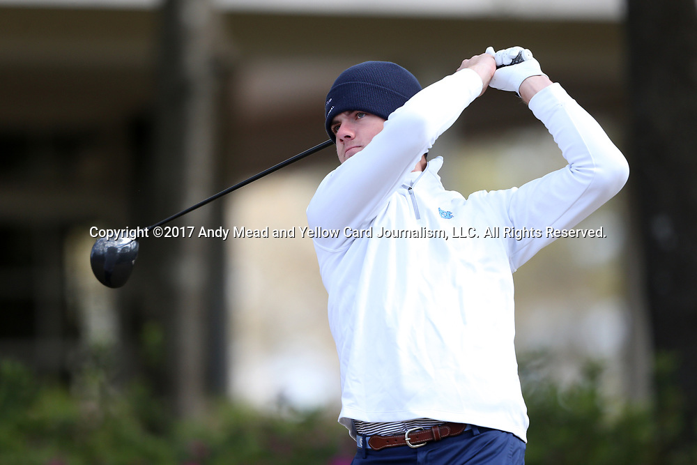 WILMINGTON, NC - MARCH 19: North Carolina's Austin Hitt tees off on the Ocean Course seventh hole. The first round of the 2017 Seahawk Intercollegiate Men's Golf Tournament was held on March 19, 2017, at the Country Club of Landover Nicklaus Course in Wilmington, NC.