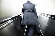 TOKYO, JAPAN, Mars 2010 - A man with a long rain coat in escalator [FR] un homme au long imperméable gris dans l'escalator