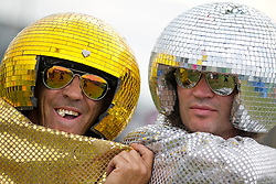 """© Licensed to London News Pictures . 24/08/2012 . Leeds , UK . Paul Burman (aka """" Disco Balls """") from Newcastle (right) with a passer by at the Leeds Festival in Bramham Park . Photo credit : Joel Goodman/LNP"""