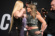 DALLAS, TX - MAY 12:  Holly Holm faces off with Bethe Correia during the UFC Summer Kickoff Press Conference at the American Airlines Center on May 12, 2017 in Dallas, Texas. (Photo by Cooper Neill/Zuffa LLC/Zuffa LLC via Getty Images) ***Local Caption***  Holly Holm; Bethe Correia