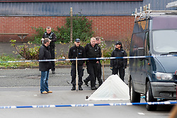 South Yorkshire Police search team and and Detectives investigate the scene of Tuesdays shooting on Cuthbert Bank Road near to Bamford street tram station <br /> <br /> 23 October 2012<br /> Image © Paul David Drabble