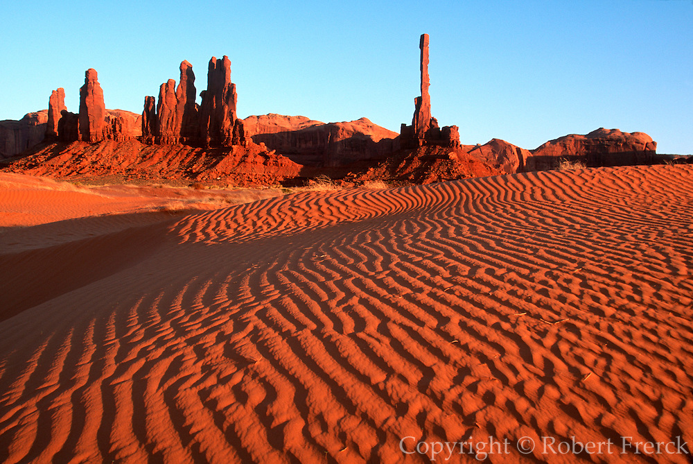 ARIZONA, MONUMENT VALLEY TRIBAL PARK on Navajo Reservation with spectacular sandstone mesas and buttes; sand dunes at Totem Pole Rock