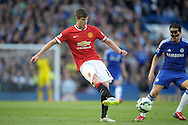 Paddy McNair of Manchester United passing the ball. Barclays Premier league match, Chelsea v Manchester Utd at Stamford Bridge Stadium in London on Saturday 18th April 2015.<br /> pic by John Patrick Fletcher, Andrew Orchard sports photography.