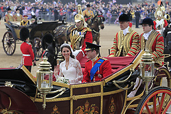 File photo dated 29/04/11 of Prince William and his wife Kate, Duchess of Cambridge, passing through Horse Guards Parade, enroute to Buckingham Palace following their marriage at Westminster Abbey in London. The Duchess of Cambridge will have spent a decade as an HRH when she and the Duke of Cambridge mark their 10th wedding anniversary on Thursday. Issue date: Wednesday April 28, 2021.