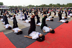 June 19, 2017 - Allahabad, Uttar Pradesh, India - Students practice Yoga ahead of ''International Yoga Day'' in Allahabad. International Day of Yoga (Hindi: Antarastriya Yoga Divas), or commonly and unofficially referred to as Yoga Day, is celebrated annually on 21 June since its inception in 2015. An international day for yoga was declared unanimously by the United Nations General Assembly (UNGA) on 11 December 2014. Y (Credit Image: © Prabhat Kumar Verma via ZUMA Wire)