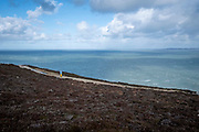 A trail walker in Holyhead Breakwater Country Park on the coast of Holyhead, on 20th February 2020 in Anglesey, North Wales, United Kingdom. The country park opened in 1990 and is on the site of an old stone quarry.