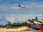 15 JUNE 2105 - BAN THONG, NARATHIWAT, THAILAND:   A Thai Smile flight comes in to land at Narathiwat Airport. Narathiwat is served by two Thai airlines: Thai Smile, the low cost subsidiary of Thai Airways, and Air Asia.     PHOTO BY JACK KURTZ