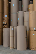 Paper is converted into corrugated cardboard made of multiple corrugated and flat layers. This final product is used for packing