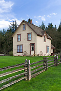 The farmhouse on the Annand/Rowlatt farmstead on a spring day.  The farmhouse was built in 1888 - Joseph and Sarah Anne Annand sold the farm in 1905.   Len Rowlatt first leased, then purchased the property and lived there for almost 60 years. The Annand/Rowlatt farmhouse is one of the oldest existing houses in the Township of Langley.  The farmhouse and surrounding buildings are now part of Campbell Valley Regional Park in Langley, British Columbia, Canada.