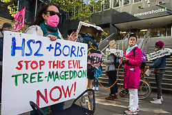 Activists from HS2 Rebellion, an umbrella campaign group comprising longstanding campaigners against the HS2 high-speed rail link as well as Extinction Rebellion activists, protest outside the offices of HS2 before marching to a protest rally in Parliament Square on 4 September 2020 in London, United Kingdom. The rally, and a later protest action at the Department of Transport during which activists glued themselves to the doors and pavement outside and sprayed fake blood around the entrance, coincided with an announcement by HS2 Ltd that construction of the controversial £106bn high-speed rail link will now commence.