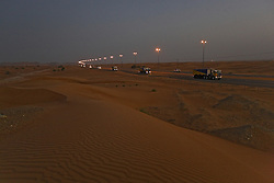 Convoys of trucks carry construction materials and supplies into Dubai through the night