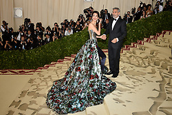 Amal Clooney and George Clooney attend the Costume Institute Benefit at The Metropolitan Museum of Art celebrating the opening of Heavenly Bodies: Fashion and the Catholic Imagination. The Metropolitan Museum of Art, New York City, New York, May 7, 2018. Photo by Lionel Hahn/ABACAPRESS.COM