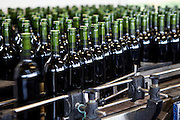 Wine bottling at the vineyard at Chateau Fontcaille Bellevue in the Bordeaux region of France