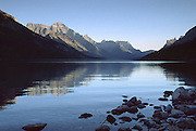 Waterton Lakes National Park, Canadian Rockies, Alberta, Canada. In 1932, Waterton-Glacier International Peace Park joined Glacier National Park in Montana with Waterton. UNESCO honored Waterton-Glacier as a World Heritage Site (1995) containing two Biosphere Reserves (1976). Geology: Rocks in these parks are primarily sedimentary layers deposited in shallow seas over 1.6 billion to 800 million years ago. During the tectonic formation of the Rocky Mountains 170 million years ago, the Lewis Overthrust displaced these old rocks over newer Cretaceous age rocks.