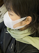 female commuter with allergy mask Tokyo Japan