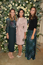 Left to right, LAVINIA BRENNAN, LUCY MECKLENBURGH and LADY NATASHA RUFUS ISAACS at a private view of the Beulah Winter Autumn Winter collection entitled 'Chrysalis' held at The South Kensington Club, London SW7 on 24th September 2015.