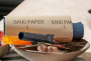 DIY concept with sandpaper, putty knife and paint roller