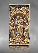 Medieval Gothic ivory diptych depicting the Virgin and child,  made in Paris in the first quarter of the 14th century.  inv 11097, The Louvre Museum, Paris. .<br /> <br /> If you prefer you can also buy from our ALAMY PHOTO LIBRARY  Collection visit : https://www.alamy.com/portfolio/paul-williams-funkystock . Type -    Medieval Ivory     - into the LOWER SEARCH WITHIN GALLERY box. Refine search by adding background colour, place, museum etc<br /> <br /> Visit our MEDIEVAL ART PHOTO COLLECTIONS for more   photos  to download or buy as prints https://funkystock.photoshelter.com/gallery-collection/Medieval-Middle-Ages-Art-Artefacts-Antiquities-Pictures-Images-of/C0000YpKXiAHnG2k