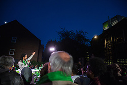 London, UK. 14 June, 2019. Rapper Akala addresses members of the Grenfell community at a gathering following the Grenfell Silent Walk on the second anniversary of the Grenfell Tower fire in which 72 people died and over 70 were injured.