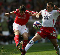 Photo: Rich Eaton. <br /> <br /> Nottingham Forest v AFC Bournemouth. Coca Cola Championship. 11/08/2007. Forest's Brendan Moloney (l) crosses tackled by Bournemouth's Gareth O'Connor (r()
