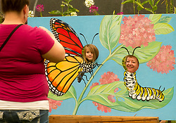 September 2, 2017 - Elkton, OREGON, U.S - People pose for photos outside the Butterfly Pavilion at the Elkton Community Education Center. In addition to the butterfly pavilion the center features a community library, a replica of Fort Umpqua, gardens, and a cafe. (Credit Image: © Robin Loznak via ZUMA Wire)