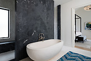 Modern or contemporary influence on a traditional bathroom design. Texas Architectural Photographer.