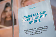 Sign in the wondow of closed down shop Primark on Oxford Street, Londons main shopping and retail area normally full of thousands of shoppers and traffic is virtually deserted due to the Coronavirus outbreak on 23rd March 2020 in London, England, United Kingdom. Following government advice most shoppers are staying at home leaving the streets quiet, empty and eerie. Coronavirus or Covid-19 is a new respiratory illness that has not previously been seen in humans. While much or Europe has been placed into lockdown, the UK government has announced more stringent rules as part of their long term strategy, and in particular social distancing.