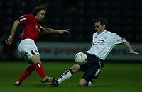 Fotball<br /> FA Cup England 2004/2005<br /> 3. runde<br /> 08.01.2005<br /> Foto: SBI/Digitalsport<br /> NORWAY ONLY<br /> <br /> Preston NE v West Bromwich Albion<br /> <br /> Graham Alexander of Preston North End tackles Jonathan Greening of West Bromwich Albion.