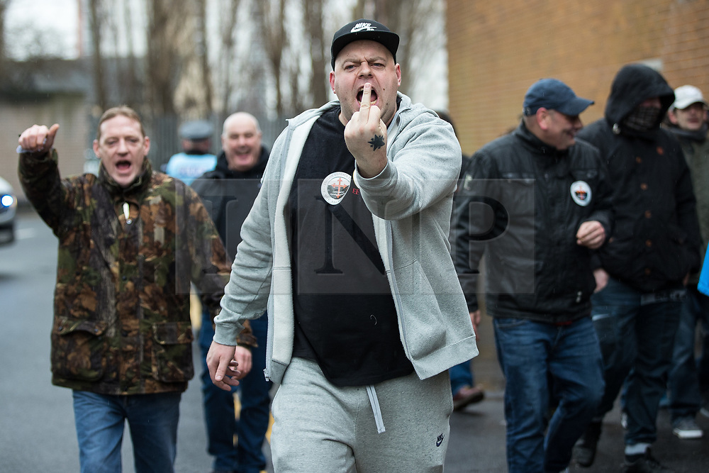 © Licensed to London News Pictures . 20/01/2018. Doncaster, UK. EDL protesters march through Hexthorpe . Far-right street protest movement , the English Defence League ( EDL ) , hold a demonstration , opposed by anti-fascists , including Unite Against Fascism ( UAF ) in the Hexthorpe area of Doncaster . EDL supporters chanted anti-Roma slogans as they marched through the town . Photo credit: Joel Goodman/LNP
