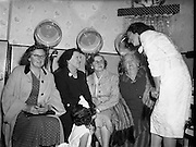 24/09/1958<br /> 09/24/1958<br /> 24 September 1958<br /> Opening of Le Pompadour Salon by the Lord Mayor of Dublin Catherine Byrne, for Mr. Victor Vinmar at 6 Upper Fitzwilliam Street, Dublin. Image shows ladies sitting under hair dryers.