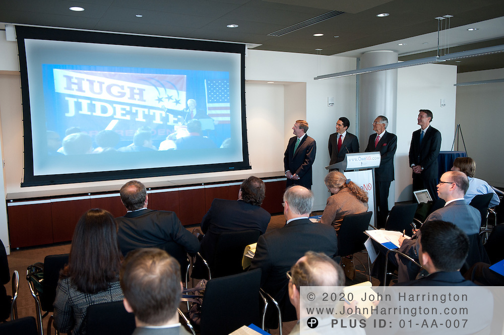 """The Peter G. Peterson Foundation presents their satirical character """"Hugh Jidette"""" that delivers a message about the country's current state of debt at the press conference launching the """"OweNo"""" campaign at the Newseum in Washington D.C. on November 9th, 2010. The goal of the campaign is to create an effective bipartisan movement to find solutions to the country's fiscal challenges. From left to right: U.S. Senate Budget Committee Chairman Kent Conrad (D-ND), PGPF Vice Chairman Michael A. Peterson, PGPF Chairman Peter G. Peterson, and Senator Evan Bayh (D-IN)."""