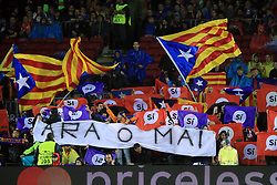 Barcelona supporters wave flags in support for Catalan independence in the stands