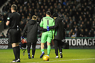 Injured Ofir Marciano is led off the pitch during the Ladbrokes Scottish Premiership match between Hibernian and Rangers at Easter Road, Edinburgh, Scotland on 19 December 2018.