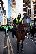 "Police horses in riot gear are deployed in The City of London along New Fetter Lane as students march through central London to protest against rises in tuition fees and changes to higher education. The police were out in force as thousands of students marched through central London. Some 4,000 officers were on duty, as demonstrators marched peacefully in a protest against higher tuition fees and ""privatisation"" in universities. The police estimated that about 2,000 people took part in the demonstration."