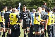 Tom Croft (centre facing) looks on during the England elite player squad rugby training session at Pennyhill Park, Bagshot, Surrey, UK on 11 March 2011. The England team play Scotland on Sunday 13th March at Twickenham. (Photo by Andrew Tobin/Focus Images)