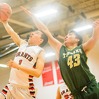 Grants Pirate Michael Anzures (1) attempts a layup under pressure from Thoreau Hawk Noah Lewis (43) during the Eddie Peña Holiday Classic at Grants High School Thursday.