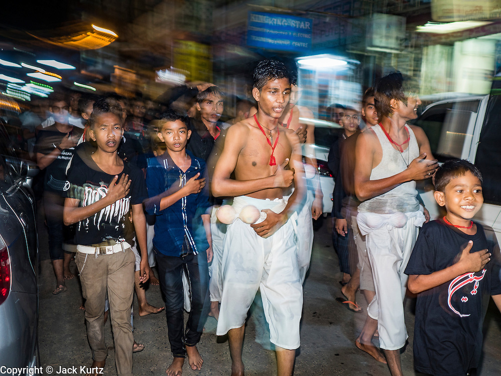 20 OCTOBER 2015 - YANGON, MYANMAR: A Shia men participate in a procession for Ashua at Punja Mosque in Yangon. Ashura commemorates the death of Hussein ibn Ali, the grandson of the Prophet Muhammed, in the 7th century. Hussein ibn Ali is considered by Shia Muslims to be the third imam and the rightful successor of Muhammed. He was killed at the Battle of Karbala in 610 CE on the 10th day of Muharram, the first month of the Islamic calendar. According to Myanmar government statistics, only about 4% of the population is Muslim. Many Muslims have fled Myanmar in recent years because of violence directed against Burmese Muslims by Buddhist nationalists.   PHOTO BY JACK KURTZ