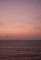 Pastel colored sky and clouds over the Pacific Ocean at dawn.  Image 10 of 21  for a panorama taken with a Fuji X-T1 camera and 35 mm f/1.4 lens  (ISO 400, 35 mm, f/2.8, 1/30 sec). Raw images processed with Capture One Pro and stitched together with AutoPano Giga Pro.