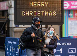 © Licensed to London News Pictures. 18/12/2020. London, UK. Commuters arrive in Westminster this morning as fears grow that the government is considering Tier 4 restrictions for London after Christmas after a spike in cases in the South East of England. Yesterday, Health Secretary Matt Hancock announced the latest updates on the government's tiering system as he plunged more of the South East including Surrey, Kent and Berkshire into Covid Tier 3 restrictions. Last Wednesday London was put into Tier 3 after a new Covid-19 variant was discovered. Photo credit: Alex Lentati/LNP