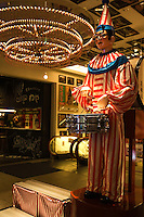 Dotombori American Clown -  famous for its historic theaters, its shops and restaurants and its many neon and mechanized signs, including candy manufacturer Glico giant electronic display of a runner crossing the finish line, moving giant crabs and other dramatic kitsch.