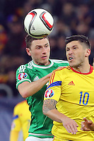 ROMANIA, Bucharest : Romania's Cristian Tanase (R) and Northern Ireland's Corry Evans (L) vie for the ball during the Euro 2016 Group F qualifying football match Romania vs Northern Ireland in Bucharest, Romania on November 14, 2014.