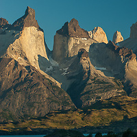 The Horns of Paine tower above Lake Pehoe in Torres del Paine National Park, Chile.