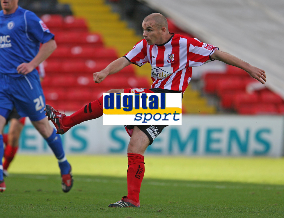 Photo: Pete Lorence.<br /> Lincoln City v Rochdale United. Coca Cola League 2. 21/10/2006.<br /> Jamie Forrester slams in the ball into the back of the net.