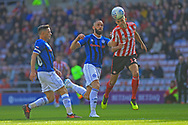 Tom Flanagan heads clear during the EFL Sky Bet League 1 match between Sunderland and Rochdale at the Stadium Of Light, Sunderland, England on 22 September 2018.