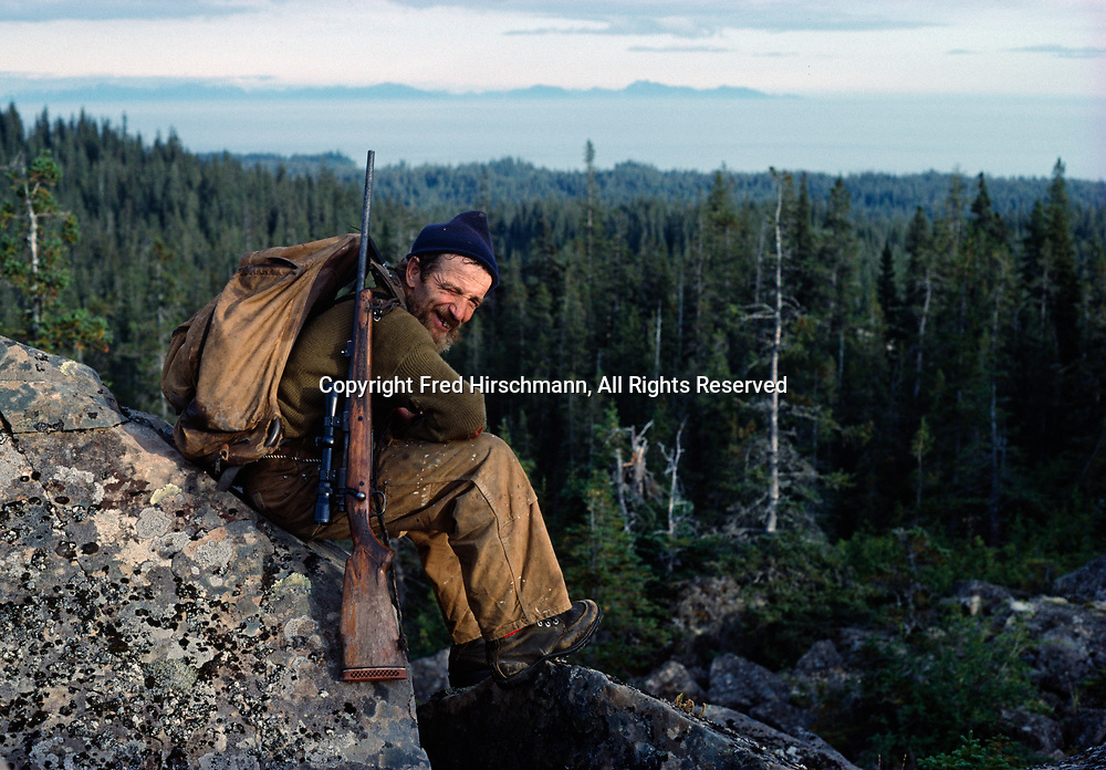 Chinitna Bay resident and trapper Wayne Byers overlooking Cook Inlet, Lake Clark National Park, Alaska.