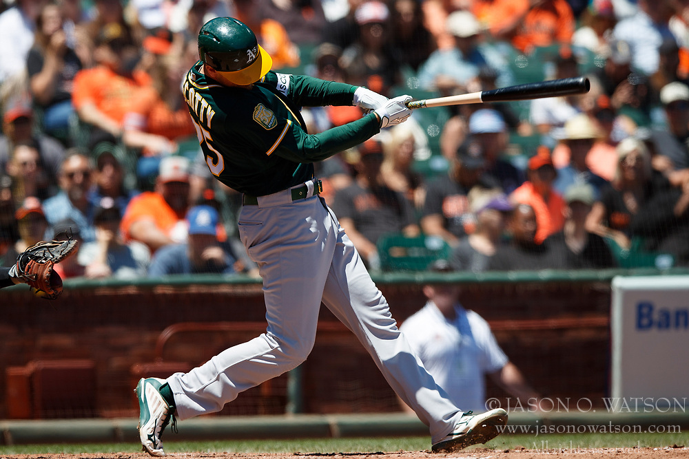 SAN FRANCISCO, CA - JULY 15: Stephen Piscotty #25 of the Oakland Athletics hits an RBI single against the San Francisco Giants during the fourth inning at AT&T Park on July 15, 2018 in San Francisco, California. The Oakland Athletics defeated the San Francisco Giants 6-2. (Photo by Jason O. Watson/Getty Images) *** Local Caption *** Stephen Piscotty
